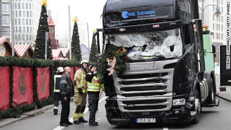 """View of the truck that crashed the evening before into a christmas market at Gedächtniskirche church on early December 20, 2016 in Berlin. German police said December 20, 2016 they were treating as """"a probable terrorist attack"""" the killing of 12 people when a lorry ploughed through a packed Berlin Christmas market. / AFP / Tobias SCHWARZ        (Photo credit should read TOBIAS SCHWARZ/AFP/Getty Images)"""