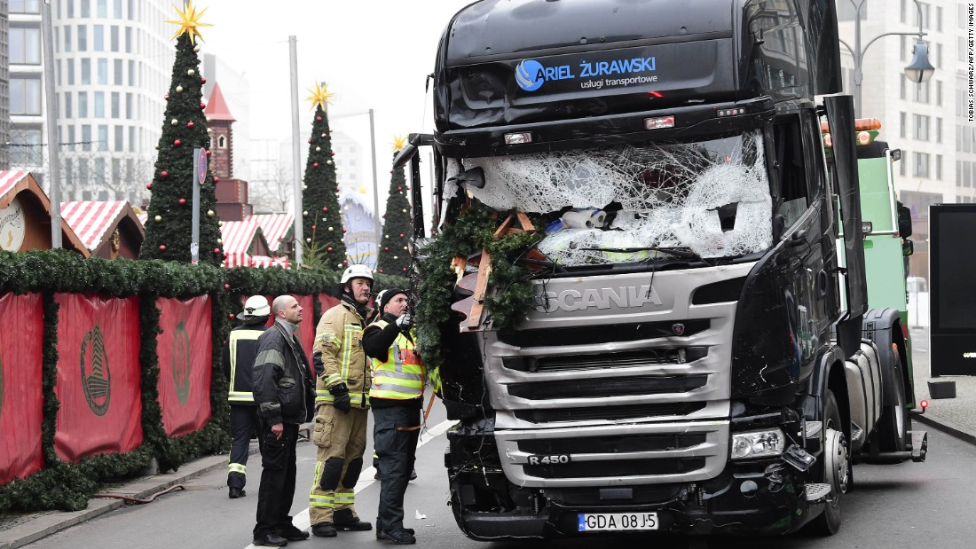 Authorities examine a truck Tuesday, December 20, that crashed into a crowded Christmas market in Berlin the night before. At least 12 people were killed and 48 injured in what police are investigating as a likely terrorist attack.