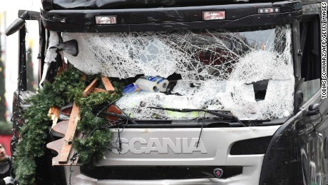 "TOPSHOT - View of the truck that crashed the evening before into a christmas market at Gedächtniskirche church on early December 20, 2016 in Berlin. German police said December 20, 2016 they were treating as ""a probable terrorist attack"" the killing of 12 people when a lorry ploughed through a packed Berlin Christmas market. / AFP PHOTO / Tobias SCHWARZTOBIAS SCHWARZ/AFP/Getty Images"