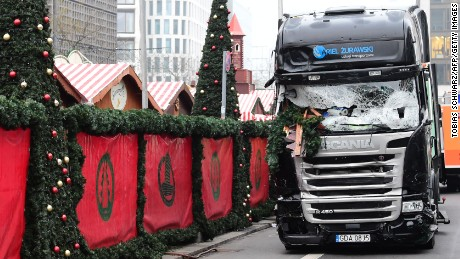 "A truck that crashed into a Christmas market near the Kaiser-Wilhelm-Gedaechtniskirche (Kaiser Wilhelm Memorial Church) in Berlin is pictured on December 20, 2016. German police said they were treating as ""a probable terrorist attack"" the killing of 12 people when the speeding lorry cut a bloody swath through the packed Berlin Christmas market."