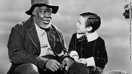"James Baskette portrayed Uncle Remus in ""Song of the South,"" which perpetuated the Lost Cause stereotype of cheerful blacks living under segregation."