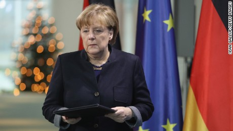 German Chancellor Angela Merkel arrives to give a statement the day after the Berlin attack.