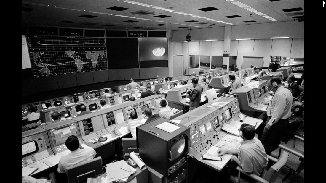 NASA's Mission Control Center on the third day of the mission. Seen on the TV monitor is a picture of Earth that Apollo 8 sent from 176,000 miles away.