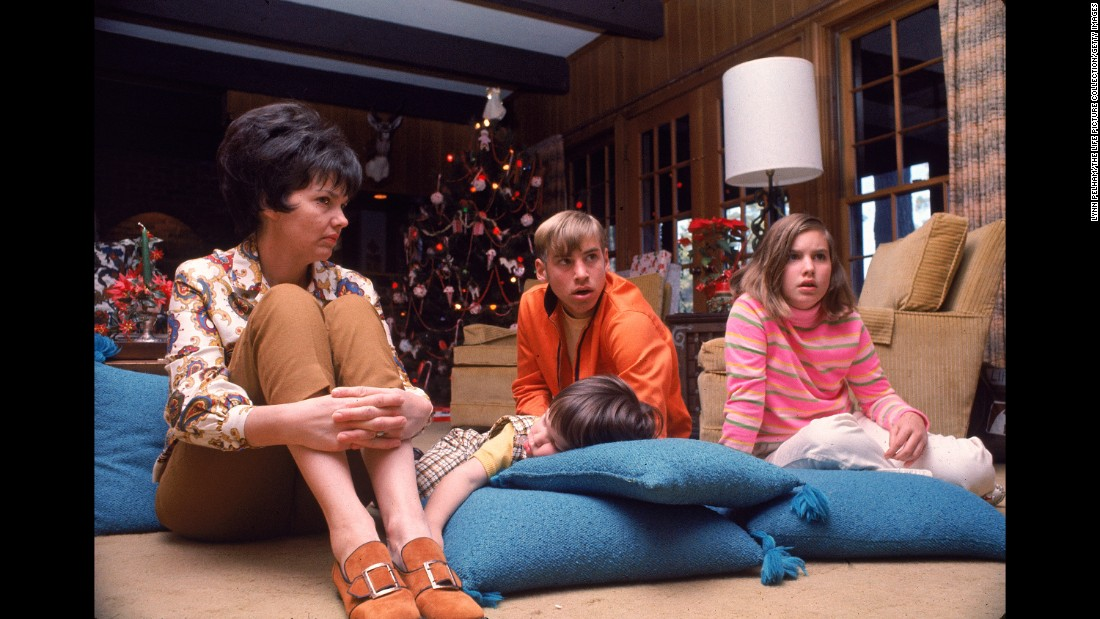 "Lovell's family watches an Apollo 8 telecast from their home in Houston. Apollo 8 had several telecasts during its mission, but <a href=""https://www.youtube.com/watch?v=ToHhQUhdyBY"" target=""_blank"">its Christmas Eve telecast</a> was the most-watched TV program ever. The crew each read from the Book of Genesis as footage of the lunar surface was sent back to Earth. ""Good night, good luck, a Merry Christmas and God bless all of you -- all of you on the good Earth,"" Borman said."