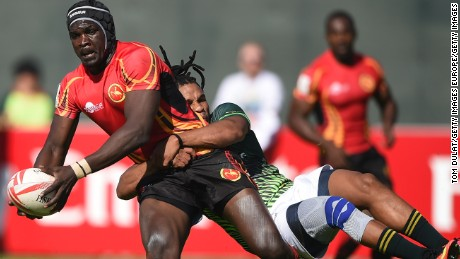 DUBAI, UNITED ARAB EMIRATES - DECEMBER 02: Michael Okorach of Uganda is tackled by Rosko Specman of South Africa during day two of the Emirates Dubai Rugby Sevens - HSBC Sevens World Series match between South Africa and Uganda on December 2, 2016 in Dubai, United Arab Emirates.  (Photo by Tom Dulat/Getty Images)