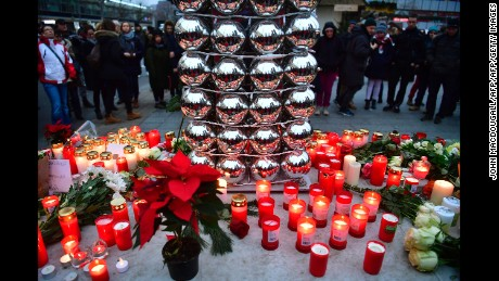 Candles are lit on December 20, 2016 at a makeshift memorial in front of the Kaiser-Wilhelm-Gedaechtniskirche (Kaiser Wilhelm Memorial Church) in Berlin, where a truck crashed the day before into a Christmas market.