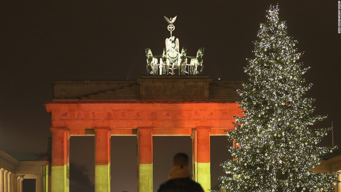 "The Brandenburg Gate in Berlin is illuminated in the colors of the German flag on Tuesday, December 20, one day after <a href=""http://www.cnn.com/2016/12/19/europe/gallery/berlin-market-attack/index.html"" target=""_blank"">a truck crashed into a crowded Christmas market</a> there. At least 12 people were killed and 48 injured in what police are investigating as a terrorist attack."