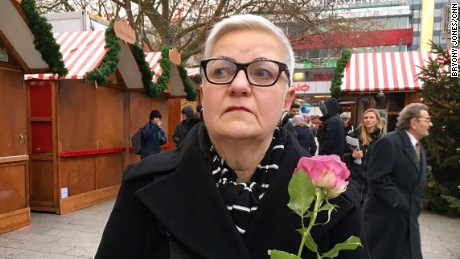 """I'm so sad,"" said Evita Baumberger, who came to lay a flower at the church."