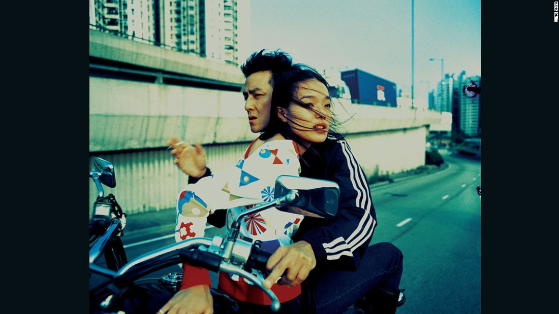 After working for Wong Kar Wai, Wing spent years shooting editorials for fashion magazine i-D. In this classic image, actress Shu Qi rides atop a motorcycle piloted through Hong Kong by Daniel Wu -- a cross-processed fantasy of youthful anomie.