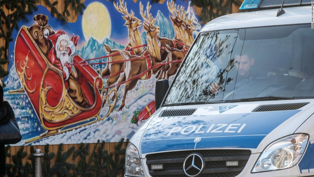 A police van drives by Christmas decorations at a Christmas market in Frankfurt, Germany, on December 20. Police presence has been stepped up at Christmas markets across Germany following the attack in Berlin.