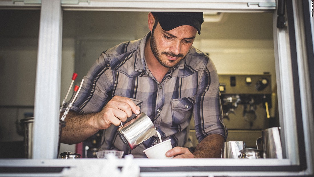 Syrian refugee Ahmad Alzoukani, who has lived in the United States for about a year, works at Refuge Coffee in Clarkston, Georgia.