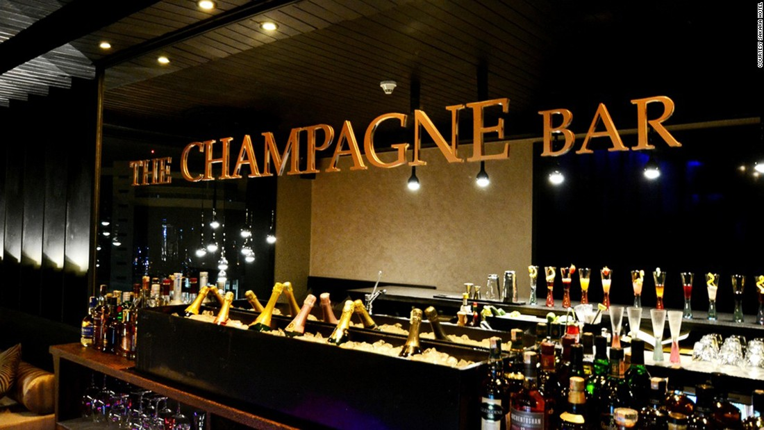 <strong>The Champagne Bar (Nairobi):</strong> Champagnes and the bar's bubbly cocktails may be the stars of this posh watering hole, but one shouldn't forget to check out the gorgeous palm wood bar -- hand carved by local artist Marc van Rampelberg -- too.