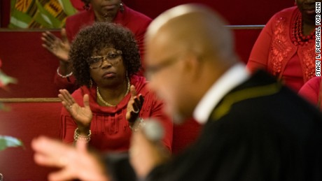 The choir watches as Manning preaches during a Sunday service last month.