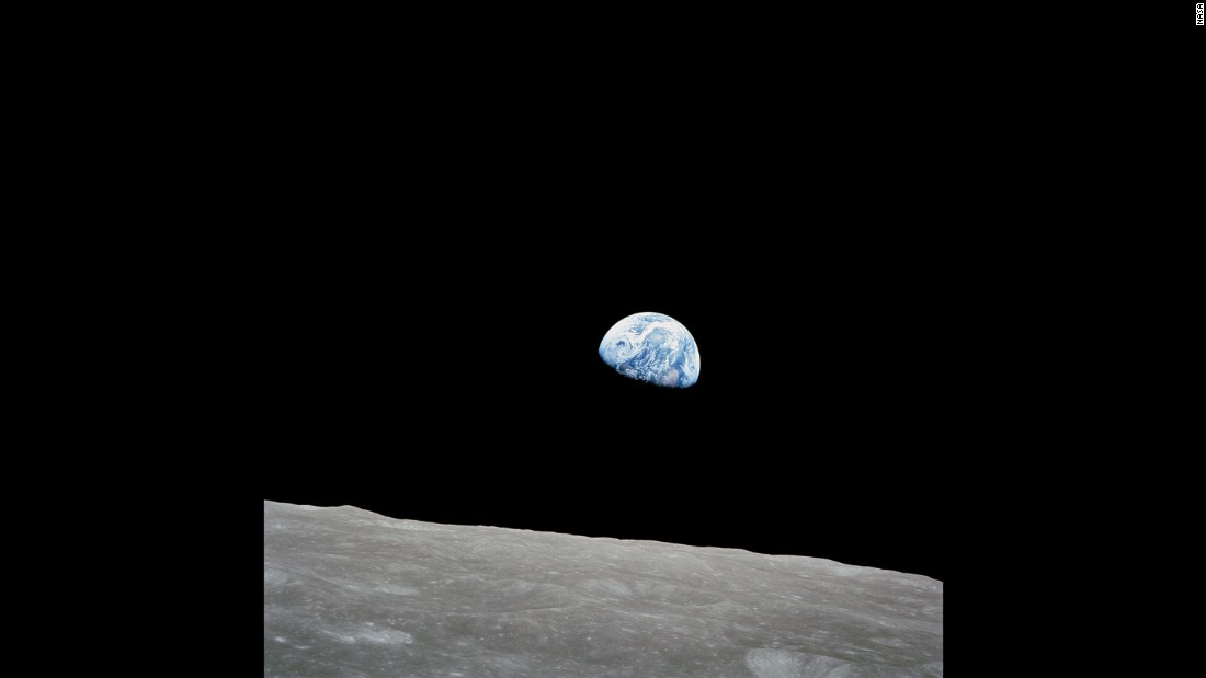 "Apollo 8 spent 20 hours orbiting the moon. Anders took this photo of Earth as it appeared to rise from the moon's surface on December 24. The photo, now nicknamed ""Earthrise,"" became one of NASA's most iconic photos. ""Oh my God! Look at that picture over there! There's the Earth coming up. Wow, is that pretty,"" Anders said in a NASA recording before asking Lovell to hand him a roll of color film."