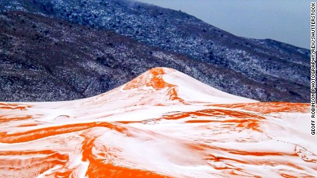"Mandatory Credit: Photo by Geoff Robinson Photography/REX/Shutterstock (7625136g) Sahara Desert with Snow Snow in the Sahara Desert, Ain Sefra, Africa - 20 Dec 2016 Picture taken on December 19th 2016 shows the snow in the Sahara desert near the town of Ain Sefra,Algeria. England is not set to have a white Christmas - but SNOW has fallen in the SAHARA desert for only the SECOND time in living memory.Amateur photographer Karim Bouchetata took incredible pictures of snow covering the sand in the small Saharan desert town of Ain Sefra,Algeria, yesterday afternoon (Mon).He captured the amazing moment snow fell on the red sand dunes in the world's largest hot desert for the first time in 37 YEARS. Snow was last seen in Ain Sefra, known as ""The Gateway to the Desert,"" on February 18, 1979, when the snow storm lasted just half an hour.This time the snow stayed for a day in the town, which is around 1000 metres above sea level and surrounded by the Atlas Mountains."