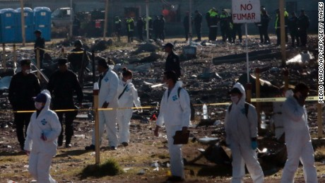 Forensic experts work on December 21, 2016 at Mexico's biggest fireworks market in Mexico City's Tultepec suburb after a massive explosion killed at least 31 people on the eve.  Thirty one people are known to have died in the Tuesday blast. Forensic experts are working on genetic analyses of the bodies because nearly all are impossible to identify. Rescue workers were still searching for bodies -- or survivors -- in the smoldering wreckage of the market in the Mexico City suburb of Tultepec, which was packed with customers buying pyrotechnics for traditional end-of-year festivities.  / AFP / PEDRO PARDO        (Photo credit should read PEDRO PARDO/AFP/Getty Images)