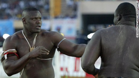"Dakar, SENEGAL:  Senegalese wrestler Mohamed Ndao, aka Tyson (L) views with Yakhya Diop (130kgs), aka ""Yekini"", 02 January 2005 at Leopold Sedar Senghor stadium in Dakar. Yekini won over Mohamed Ndao. AFP PHOTO SEYLLOU  (Photo credit should read SEYLLOU/AFP/Getty Images)"