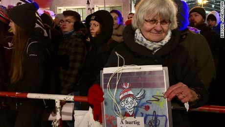 Irmela Schramm, 70, was demonstrating on the pro-refugee side. She has traveled around Germany for years, painting over neo-Nazi graffiti with heart shapes.