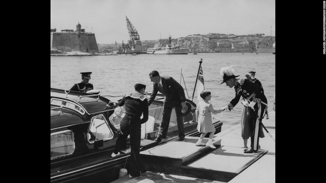 Prince Charles, right, shakes hands with Sir Gerald Creasy, the governor of Malta, as he and the rest of the royal family visit Malta in May 1954.