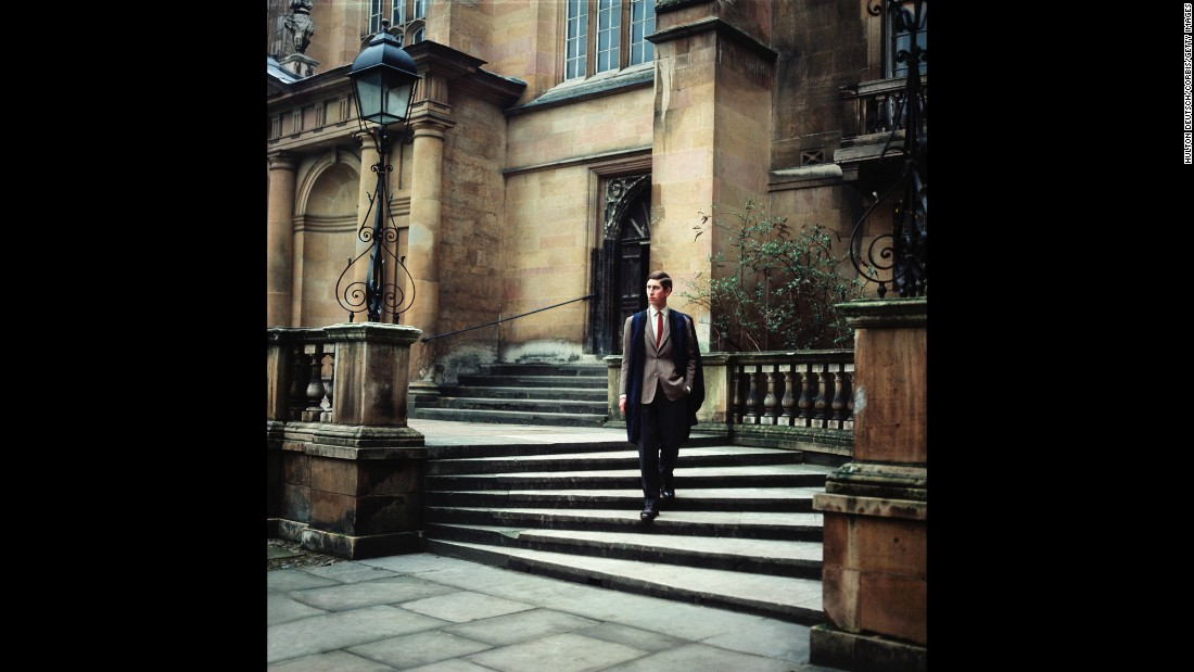 Prince Charles walks at Trinity College, Cambridge, where he earned a bachelor's degree in 1970. He was the first royal heir to earn a university degree.