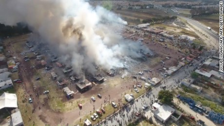A massive explosion guts Mexico's biggest fireworks market in Tultepec on December 20, 2016 killing at least 31 people. The explosion killed at least 31 people and injured 72, authorities said. The conflagration in the Mexico City suburb of Tultepec set off a quick-fire series of multicolored blasts that sent a vast cloud of smoke billowing over the capital. / AFP / Josue SOLANO        (Photo credit should read JOSUE SOLANO/AFP/Getty Images)
