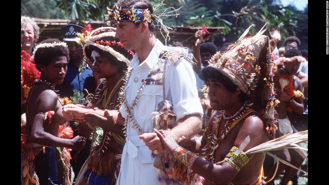 Prince Charles walks with natives on a visit to Papua New Guinea in 1984.