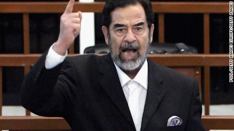 Former Iraqi President Saddam Hussein shouts as he receives his guilty verdict during his trial in the fortified 'green zone', on November 5, 2006 in Baghdad, Iraq.