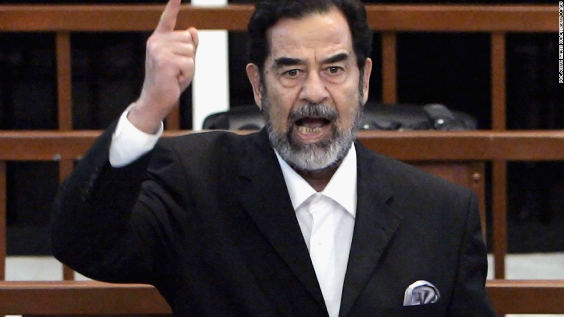 "Former Iraqi President Saddam Hussein as he receives his guilty verdict during his trial in the fortified ""green zone,"" on November 5, 2006 in Baghdad, Iraq."