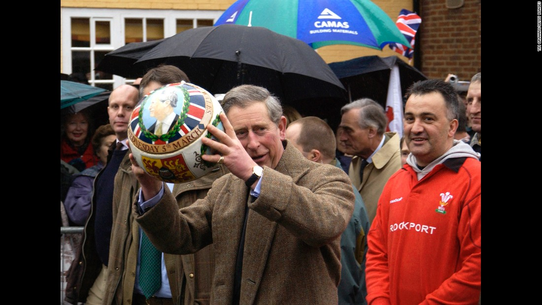 Prince Charles carries a specially painted football through the streets of Ashbourne, England, in March 2003.