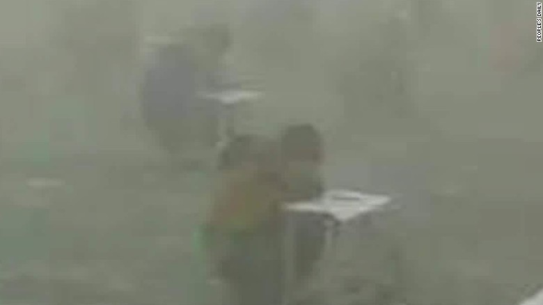 china students take test surrounded by smog walker sater_00000811