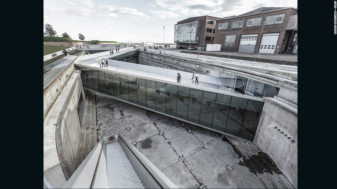 The sloping zig-zag bridges allow visitors to navigate within and around the dock, 23 ft (7 meters) below the ground.