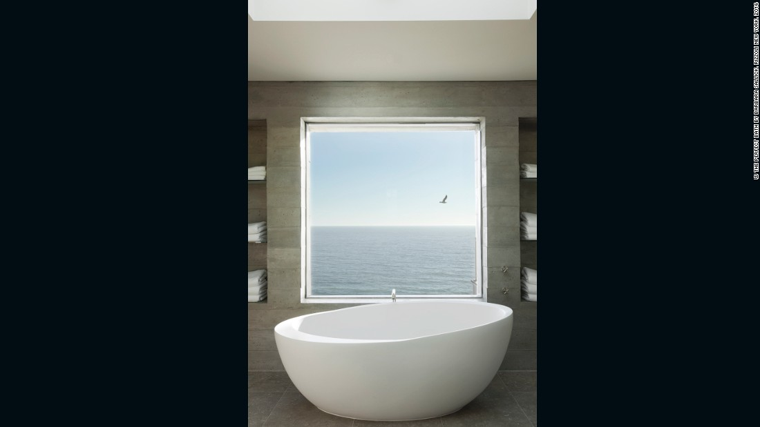 "California-based Tim Clarke lets nature lead the way in his bathroom designs. ""Another way to integrate the interior and exterior is to...treat the view as artwork within the room,"" says Clarke in ""The Perfect Bath"" by Barbara Sallick. ""Sometimes I will frame the view with a square or even slightly vertical window, so that the proportions of sky, sea, and sand read as an abstract canvas."""