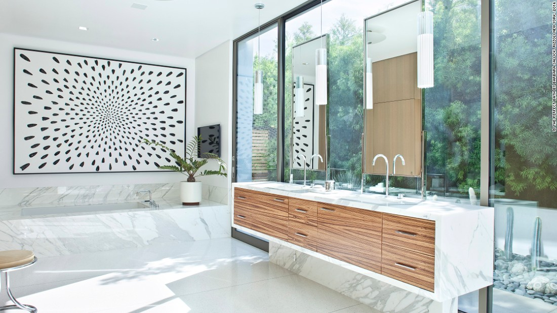 "Sallick, a designer herself, encourages bathrooms to reflect a home's overall aesthetic. ""Go in a direction that is in sympathy with the style of your home. If a material is stridently out of context, you'll regret it -- and as it has been crafted at great expense, you will have no choice but to live with it,"" she says."