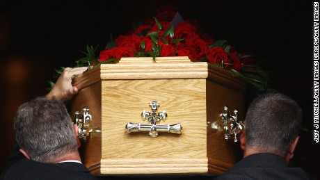 GLASGOW, UNITED KINGDOM - AUGUST 19: The coffin of shipyard and trade union icon Jimmy Reid enters Govan Old Parish Church on August 19, 2010 in Glasgow, Scotland. Hundreds of mourners gathered in Govan to pay their respects to the 78 year old Mr Reid who died last week after suffering haemorrhage. Mr Reid, was at the forefront of the trade unionist movement, leading a successful work in at the Upper Clyde Shipbuilders, preventing the government attempts to close the yards.  (Photo by Jeff J Mitchell/Getty Images)