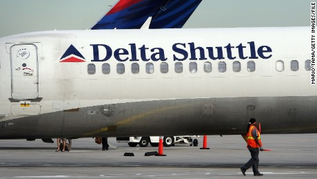 NEW YORK - OCTOBER 16:  A worker walks past a Delta Air Lines plane at LaGuardia International Airport October 16, 2007 in New York City. Delta's profit rose to $220 million, compared with $52 million a year ago, when Delta was under Chapter 11 bankruptcy protection. (Photo by Mario Tama/Getty Images)