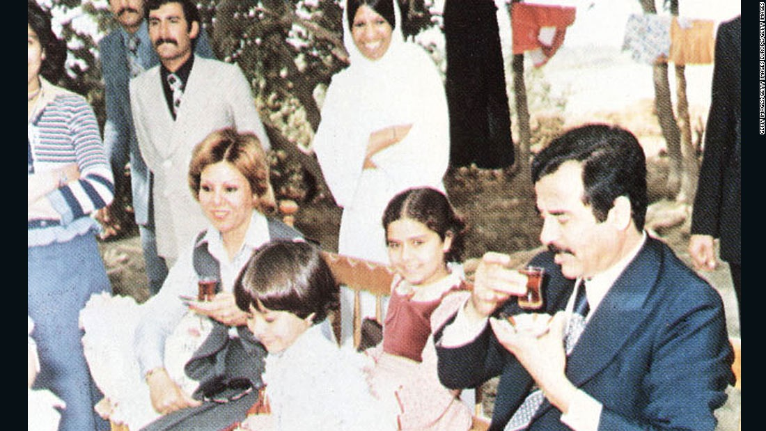 In this undated photo, Saddam Hussein, his daughters Ragad and Rana, and first wife Sajida during a visit with family friends on the outskirts of Baghdad.