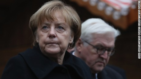 BERLIN, GERMANY - DECEMBER 20:  German Chancellor Angela Merkel and Foreign Minister Frank-Walter Steinmeier depart after laying flowers near where yesterday a lorry ploughed through a Christmas market on December 20, 2016 in Berlin, Germany. So far 12 people are confirmed dead and 45 injured. Authorities have confirmed they believe the incident was an attack and have arrested a Pakistani man who they believe was the driver of the truck and who had fled immediately after the attack. Among the dead are a Polish man who was found on the passenger seat of the truck. Police are investigating the possibility that the truck, which belongs to a Polish trucking company, was stolen yesterday morning.  (Photo by Sean Gallup/Getty Images)