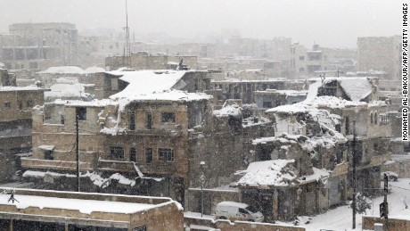 TOPSHOT - A picture shows ruins covered in snow in the town of Maaret al-Numan, in Syria's northern province of Idlib, on December 21, 2016. Rebels and civilians who have sought refuge in the opposition-held province of Idlib, most recently from second city Aleppo, say they are suffering from skyrocketing prices and overpopulation. At least 25,000 people, including rebel fighters, have left east Aleppo since last week under an evacuation deal that will see the city come under full government control.   / AFP / Mohamed al-Bakour        (Photo credit should read MOHAMED AL-BAKOUR/AFP/Getty Images)