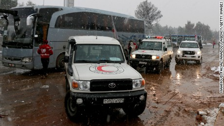 Snowfall has slowed convoys evacuating people from eastern Aleppo.