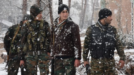 Snow falls on pro-government forces Wednesday in Aleppo.