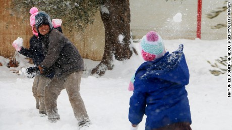 Syrian children throw snowballs this week at a displacement camp in Aleppo province.