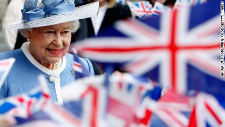 LONDON, ENGLAND - JUNE 21: Union Jacks are waved as Queen Elizabeth II departs following the 300th Anniversary Service of St Paul's Cathederal, on June 21, 2011 in London, England.  The anniversary comes after restoration work which took 15 years to complete and cost 40 million GBP, and repaired damage left from World War II.  (Photo by Akira Suemori/WPA Pool/Getty Images)