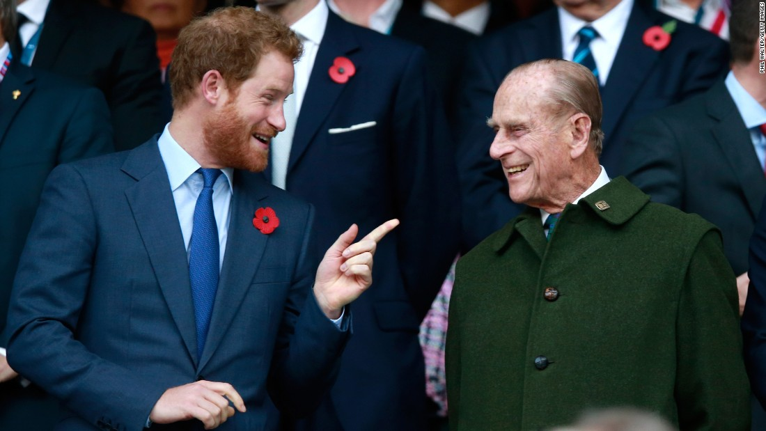 Prince Phillip and his grandson Prince Harry attend the Rugby World Cup final in October 2015.
