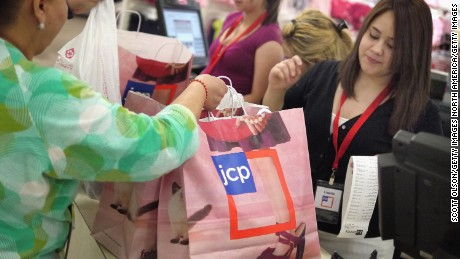 NORTH RIVERSIDE, IL - FEBRUARY 01:  Lisette Barraza (R) hands a shopper her merchadise in a bag displaying the new store logo at a JCPenney store in the North Riverside Park Mall February 1, 2012 in North Riverside, Illinois. J.C. Penney Company Inc., the parent company of JCPenney, today rolled out a major transformation of its JCPenney stores which included a new pricing structure that offers fewer sales, monthly specials, and more predictable pricing. The stores will also add new merchandise brands to their existing lines and display the new store logo.  (Photo by Scott Olson/Getty Images)