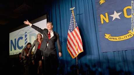 North Carolina Democratic presumptive Governor elect Roy Cooper waves to a crowd at the North Carolina Democratic Watch Party as he walks on stage with his family on November 9, 2016 in Raleigh, North Carolina.