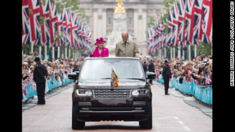The Queen and Prince Philip wave to guests attending celebrations in London for her 90th birthday in 2016.