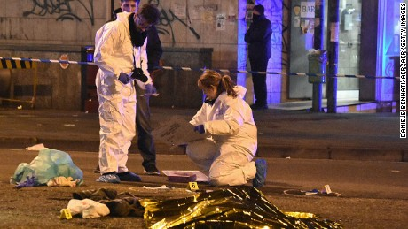 Italian police and forensics experts gather around the body of suspected Berlin truck attacker Anis Amri.