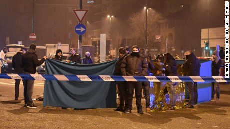 Italian authorities cordon off the area Friday where Amri was shot.