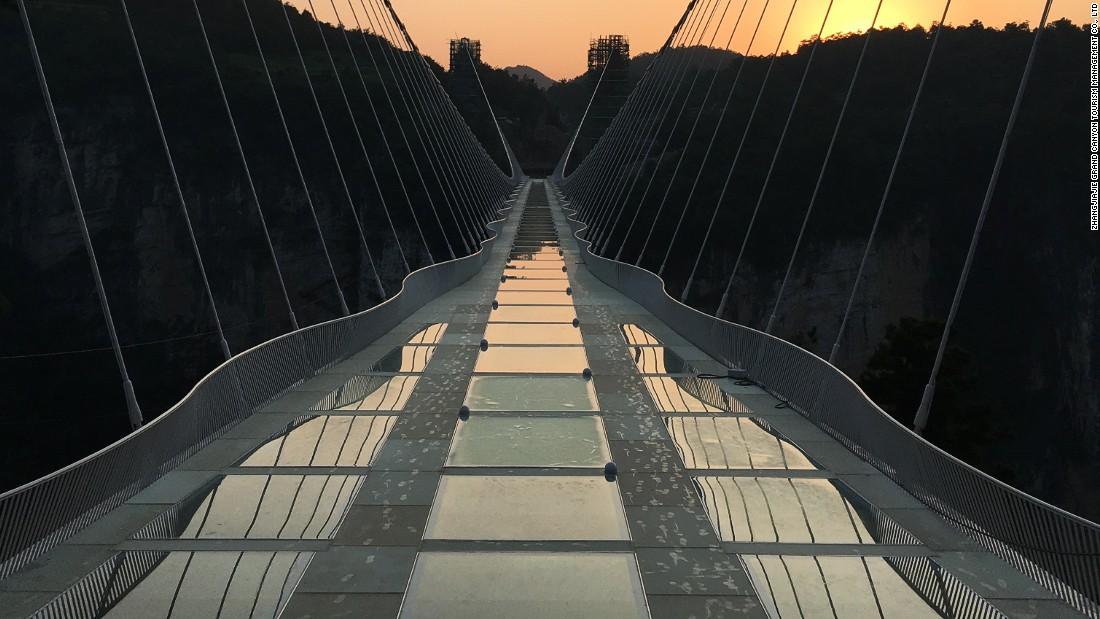 "Haim Dotan's $3.4 million glass bridge is a staggering structure by any measure. But it's not meant to steal the show. It was designed to be an invisible ""white bridge disappearing into the clouds,"" according to a statement."