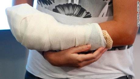 Kvitova holds her bandaged hand after addressing media in Prague.